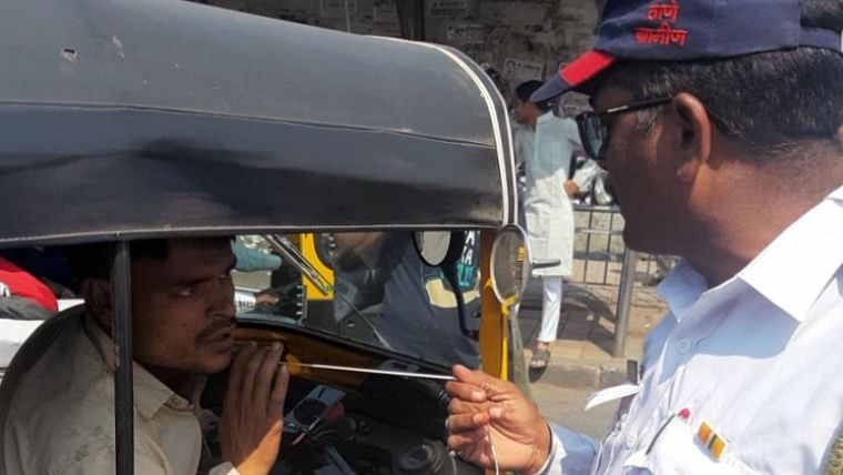 Police confiscate and burn nearly 250 earphones of erring auto-rickshaw drivers