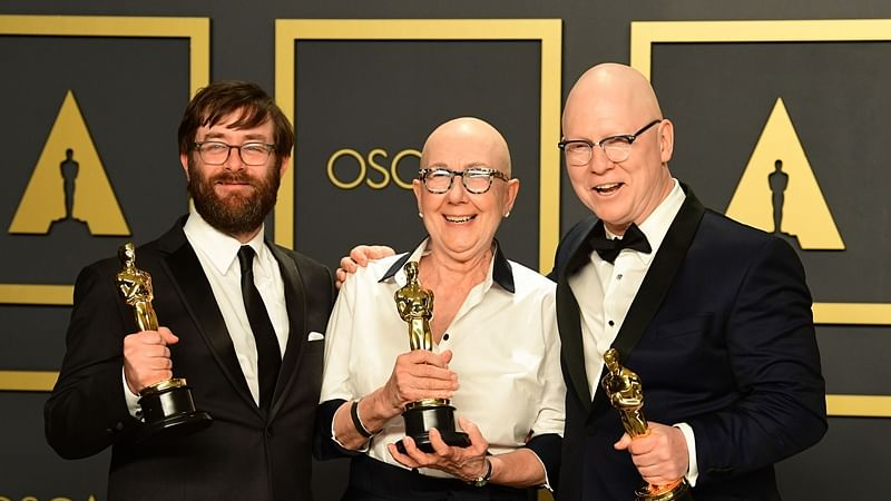 "US directors Julia Reichert, Jeff Reichert (R) and steven Steven Bognar (L) pose in the press room with the Oscar for Best Documentary Feature for ""American Factory"""