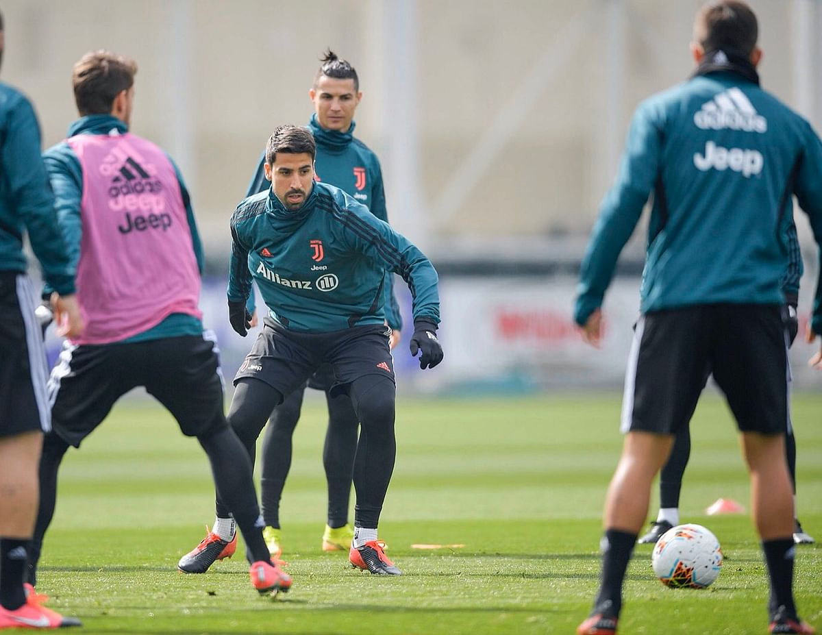 Juventus mid-fielder Sami Khedira  (centre)