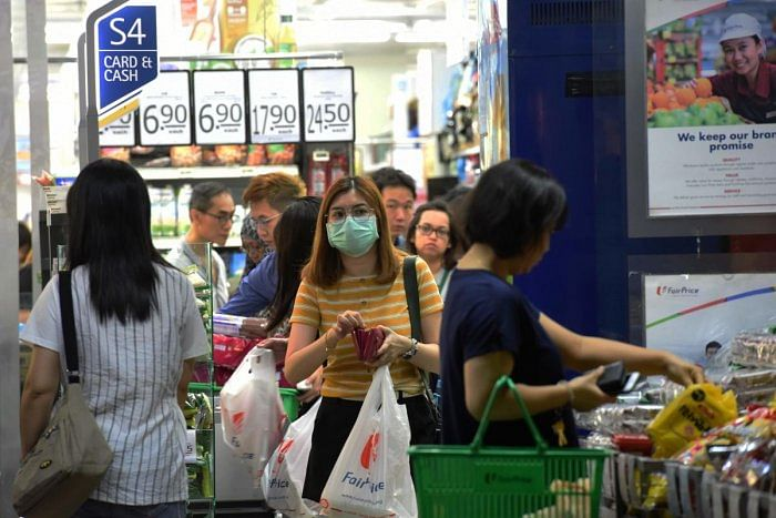 A woman wearing a facemask amid fears about the spread of the coronavirus, at a supermarket in Singapore.