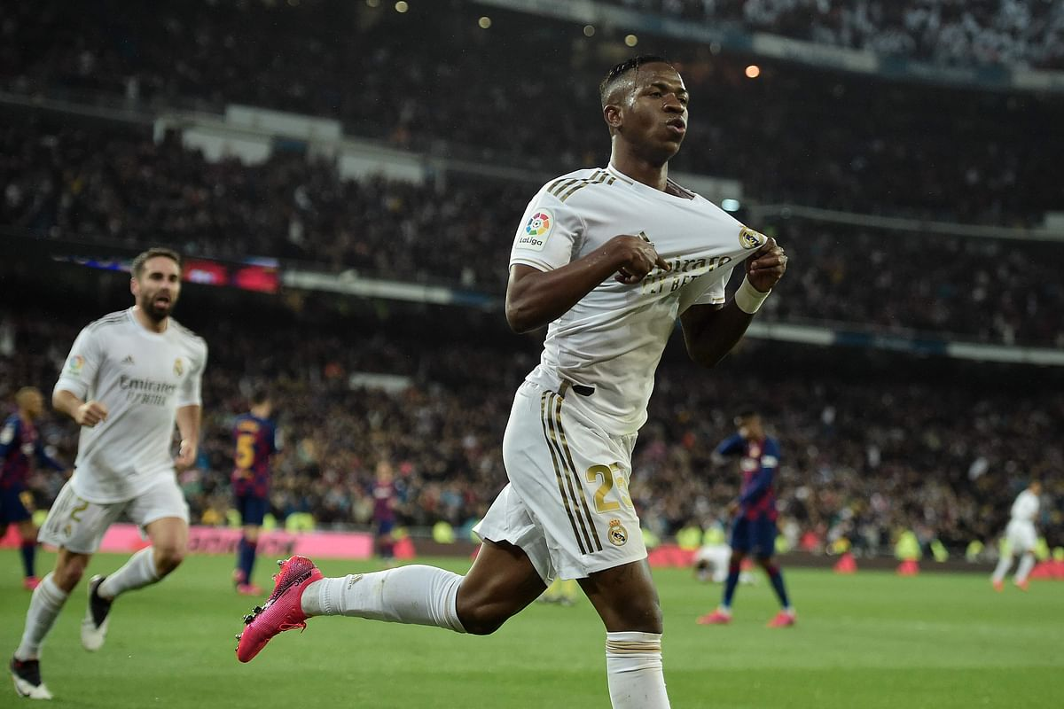 Real Madrid's Brazilian forward Vinicius Junior celebrates a goal during the Spanish League football match between Real Madrid and Barcelona at the Santiago Bernabeu stadium in Madrid on March 1, 2020.