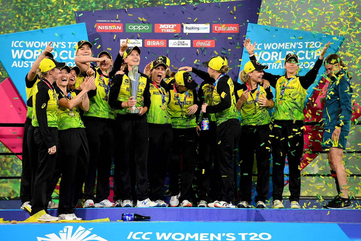 Australia's players celebrate after winning the Twenty20 women's cricket World Cup final between Australia and India in Melbourne