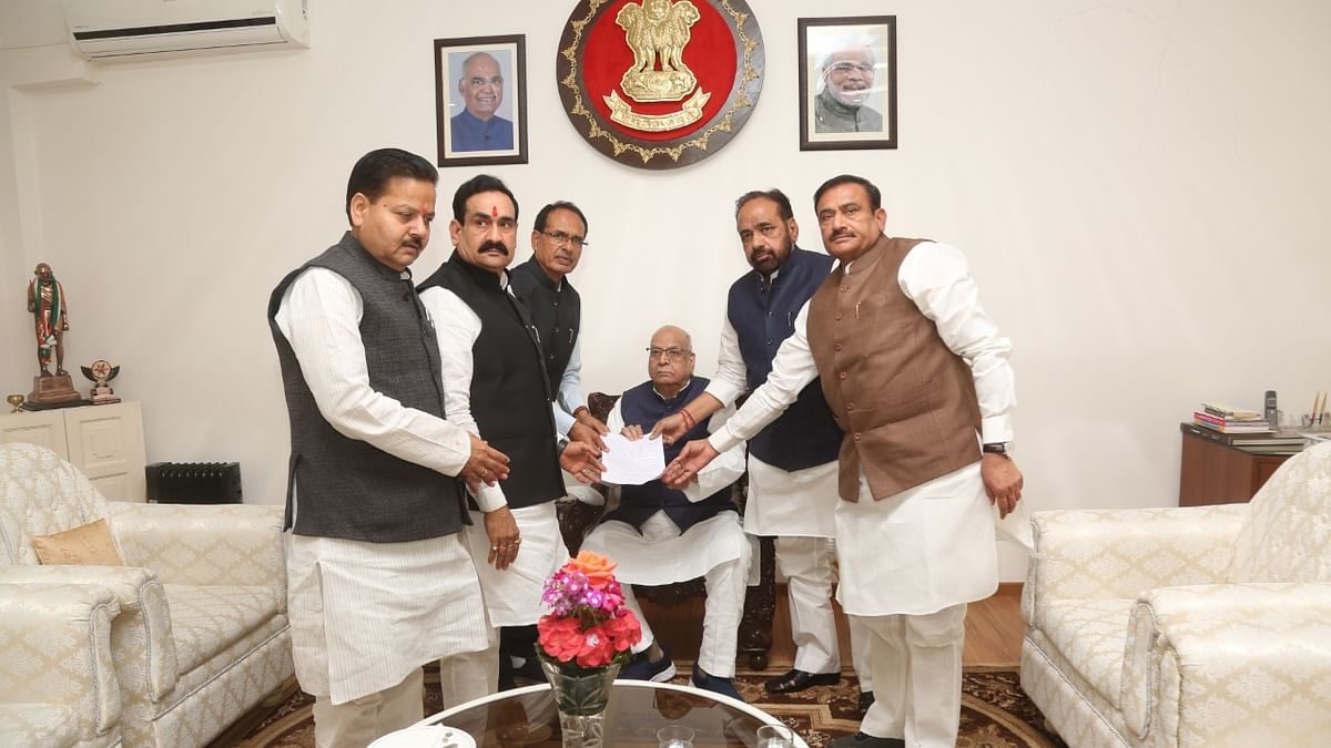 BJP delegation led by former Chief minister Shivraj Singh Chauhan accompanied by Leader of Opposition Gopal Bharagava hand over memorandum to Governor Lalji Tandon demanding floor test for Kamal Nath government to  prove majority.