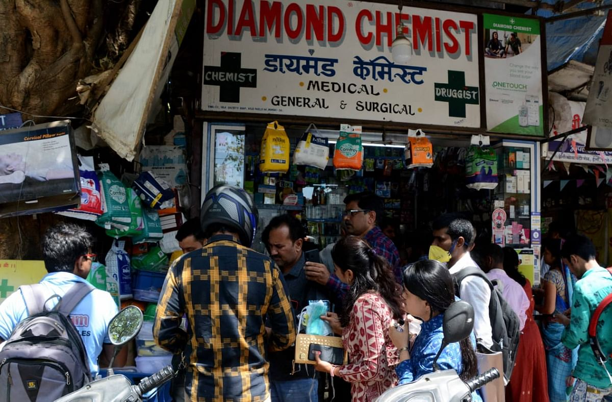 People flock to medical store to buy face masks and sanitizer