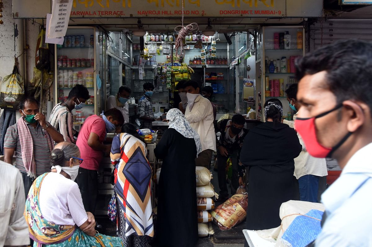 Customers came out to buy daily essentials in a provisional store at Dongri.