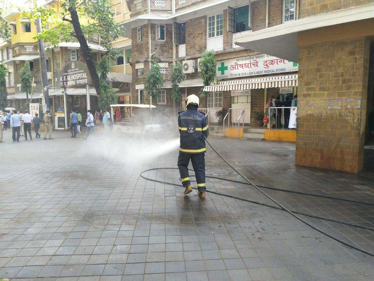 Mumbai Fire Brigade staffer use sodium hydrochloride solution diluted in water to disinfect the premises