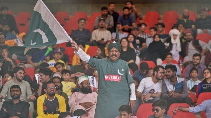 A fan waving Pakistan national flag in a PSL match played at National Stadium, Karachi.