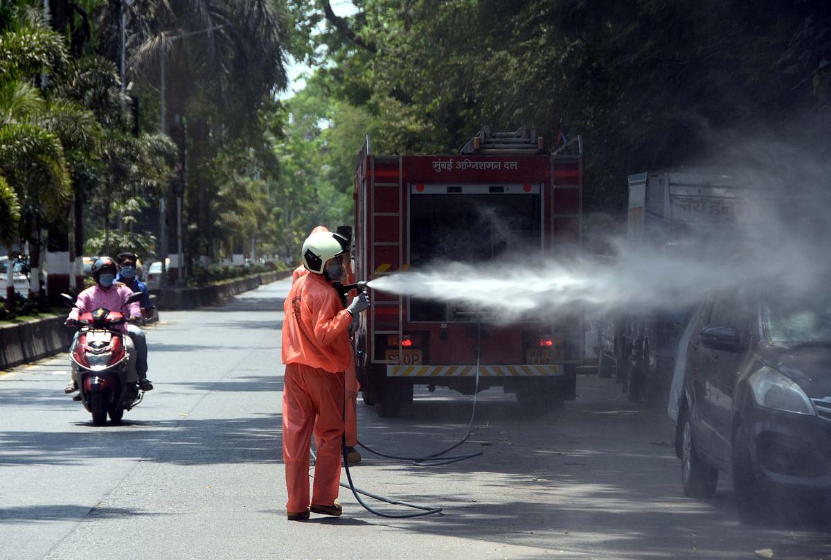 fire brigade personnel sanitize Machimar Colony in Mahim.