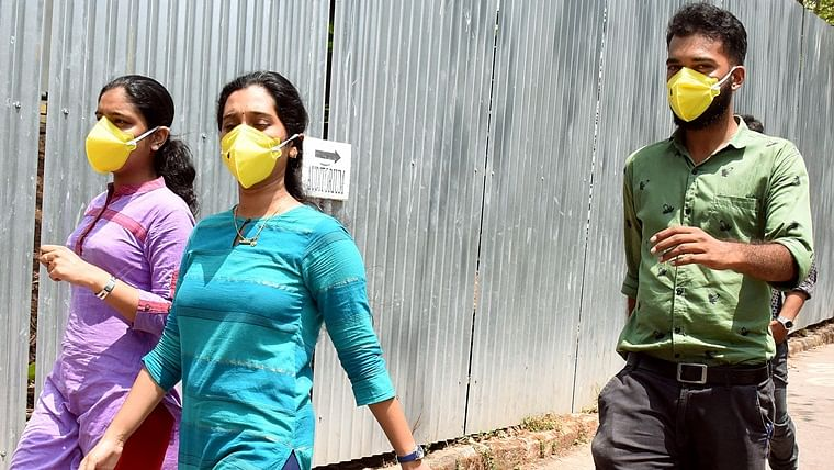 People wear masks in awake of deadly coronavirus infection outside the Special Isolation Ward at Medical college, in Kochi