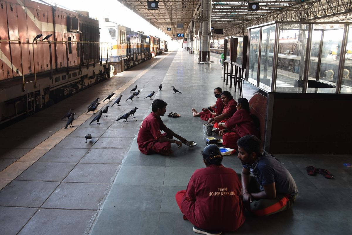Porters having food as all trains have been shut down.
