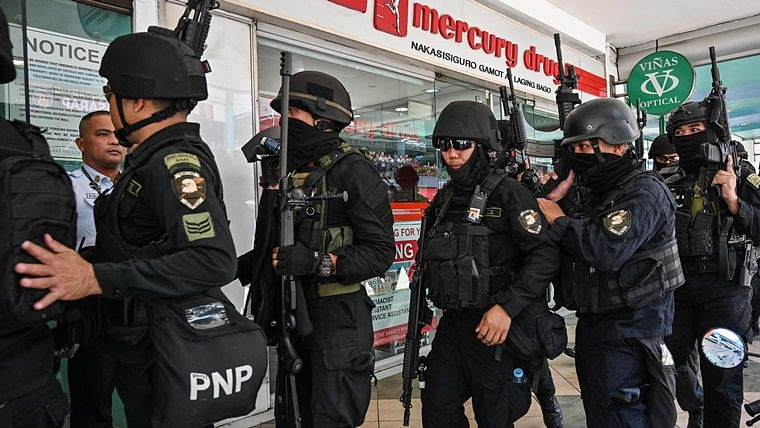 Irked by dismissal, security guard takes around 30 people hostage at gunpoint in Philippines mall