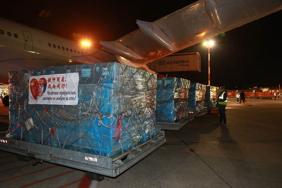 Medical supplies donated by the Chinese government are unloaded from an airplane in Belgrade, Serbia, March 21, 2020.