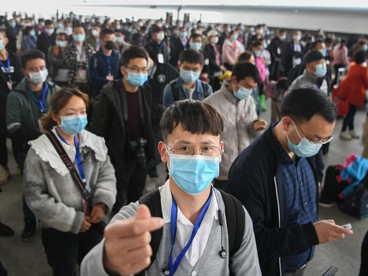 A worker named Chen Anxin (front) prepares to get on a train in Jingzhou.
