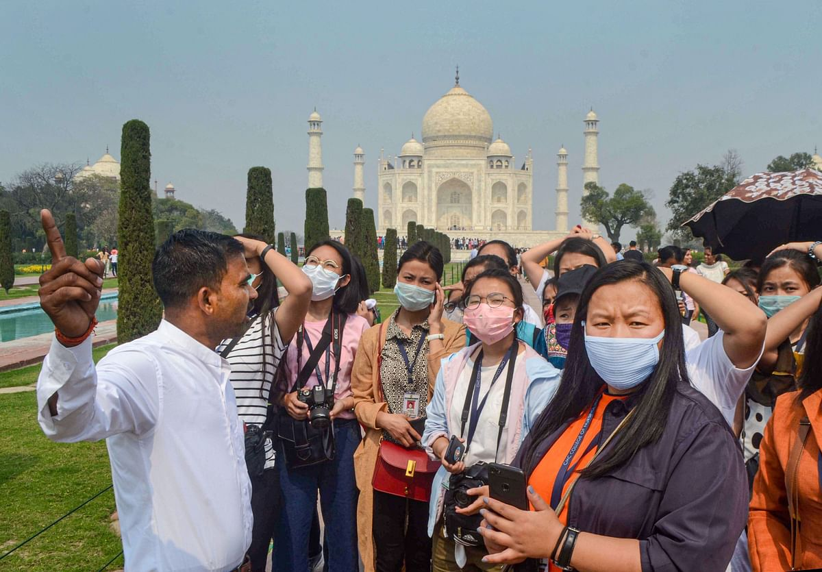 Agra: Tourists wear protective masks in wake of the deadly novel coronavirus, at Taj Mahal, in Agra, Tuesday, March 03, 2020.