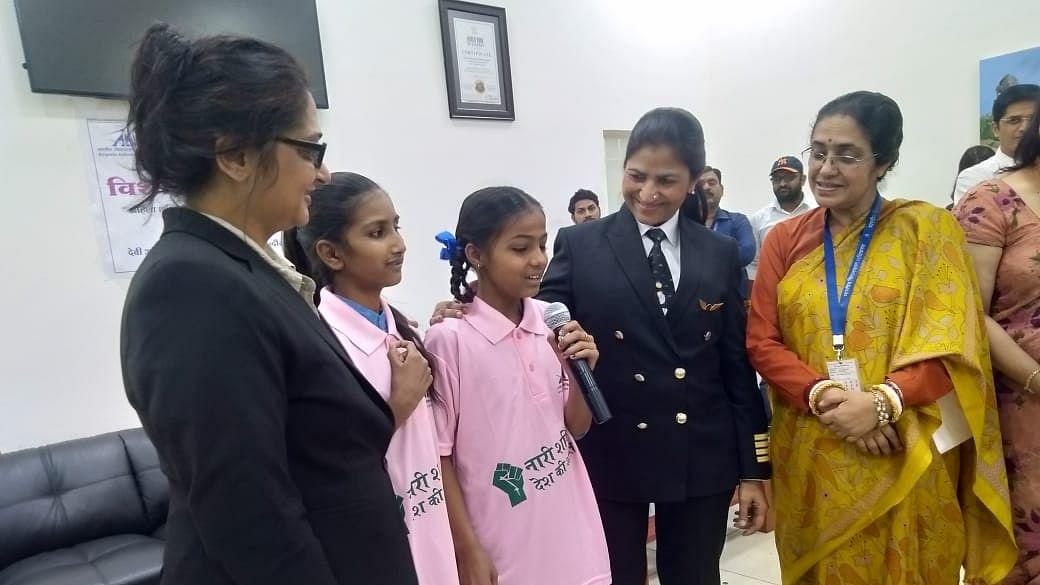 Aircraft Commander Nivedita Bhasin and Airport Director Aryama Sanyal interacting to girls of Govt. School at the city airport on Saturday.