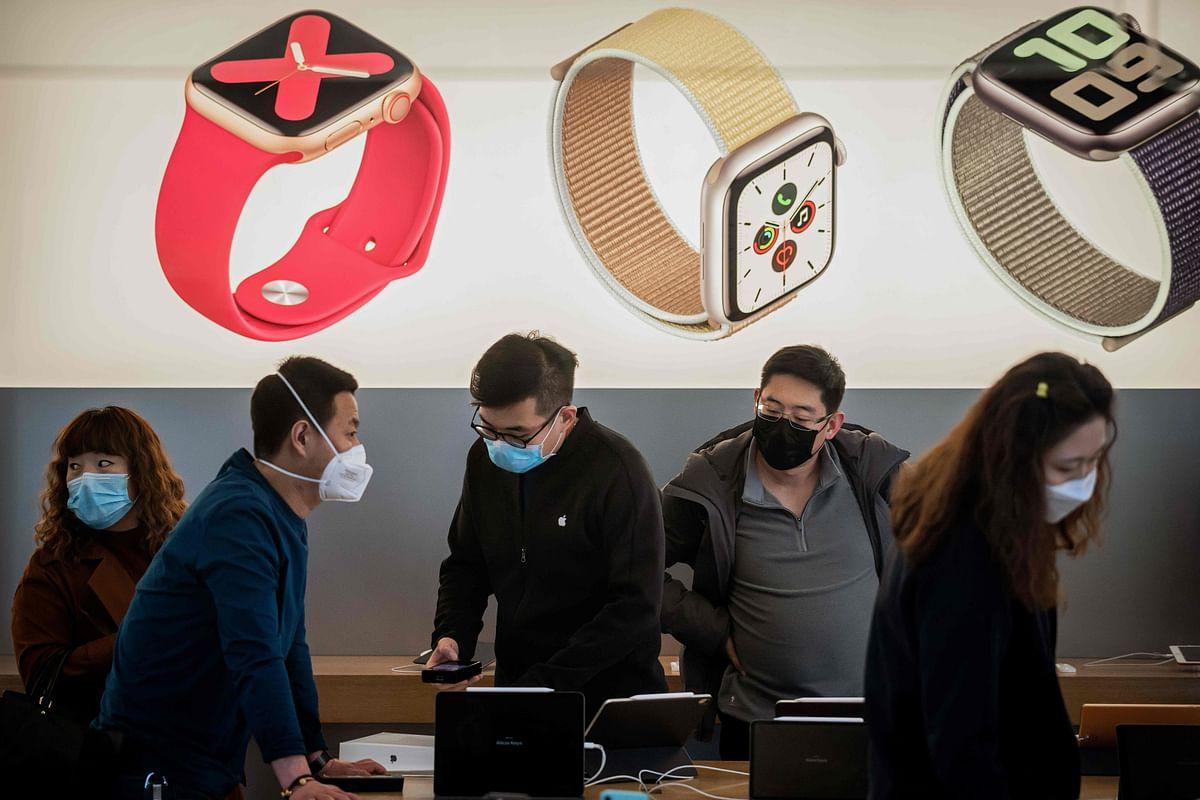People in a gadget shop in Beijing