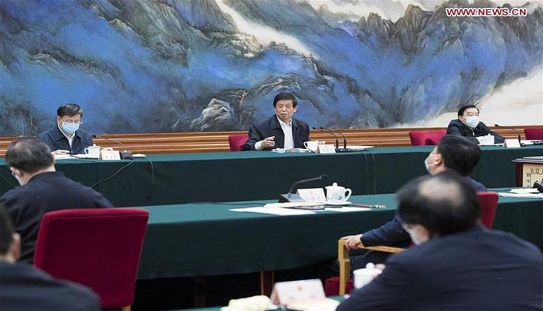 China's top legislator calls for improving public health legislation, law revision
