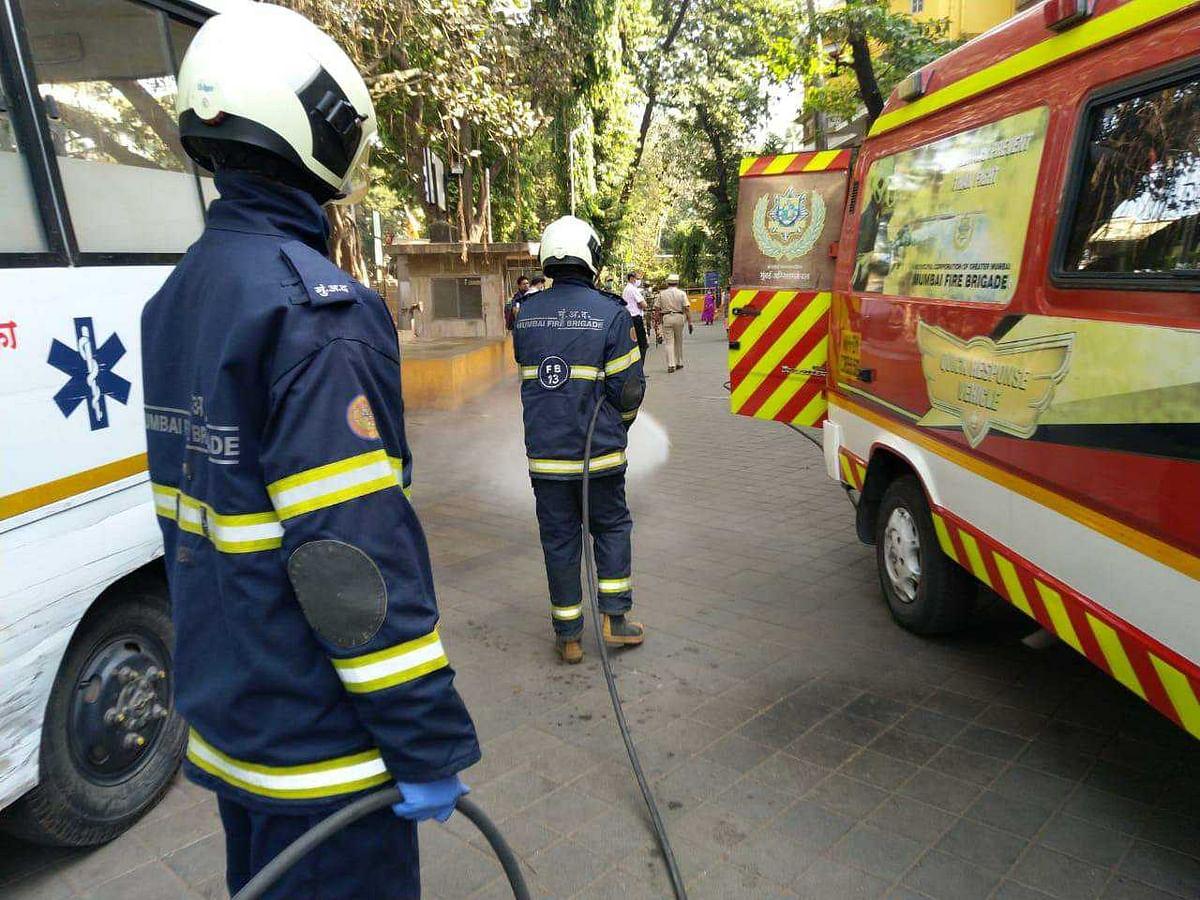 Mumbai Fire Brigade staffer disinfect the area near the hospital premises