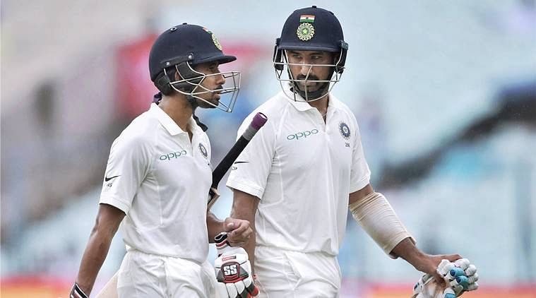 Wriddhiman Saha and Cheteshwar Pujara