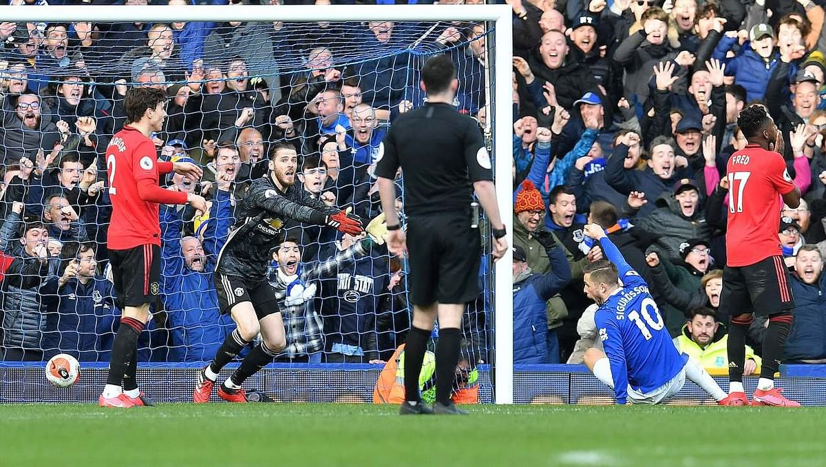 Everton's  midfielder Gylfi Sigurdsson (second from right) celebrates a goal that was later ruled out by Video Assistant Referee (VAR) in Premier League match between Everton and Manchester United at Goodison Park on Sunday.
