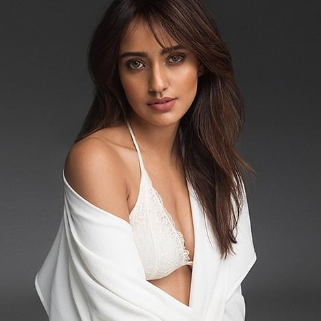 'This is called Samaj Seva': Twitter reacts to Neha Sharma's 'distracting' picture amid coronavirus scare