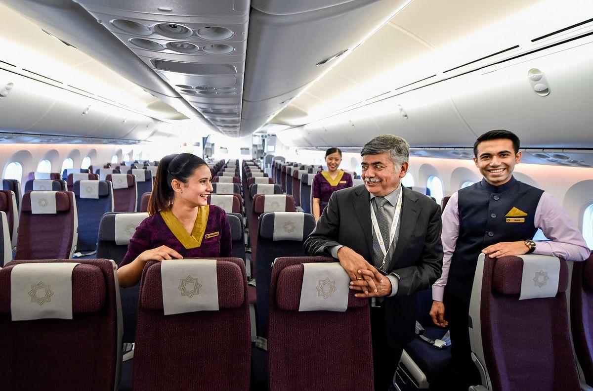 Chairman Bhaskar Bhat (C) interacts with Vistara cabin crew  during the launch of Vistara Boeing 787-9 Dreamliner, in New Delhi on Monday.