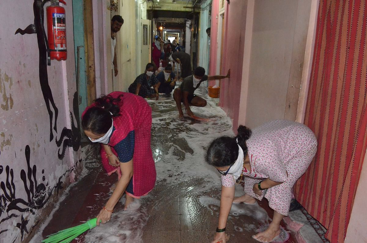 Residents  of Shivneri building cleaning their floor by soap water as a preventive measure from coronavirus disease at Dadar on Tuesday.