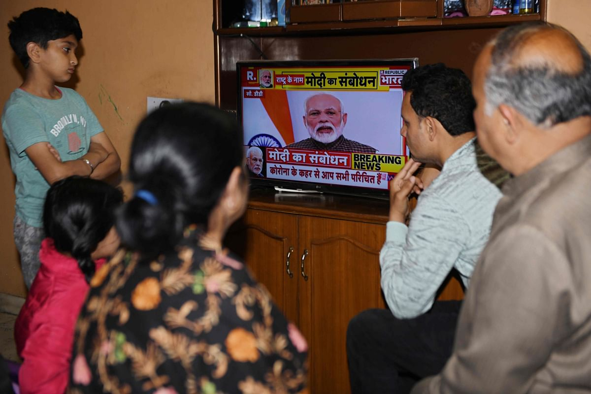 People listen to PM Modi's address on Tuesday