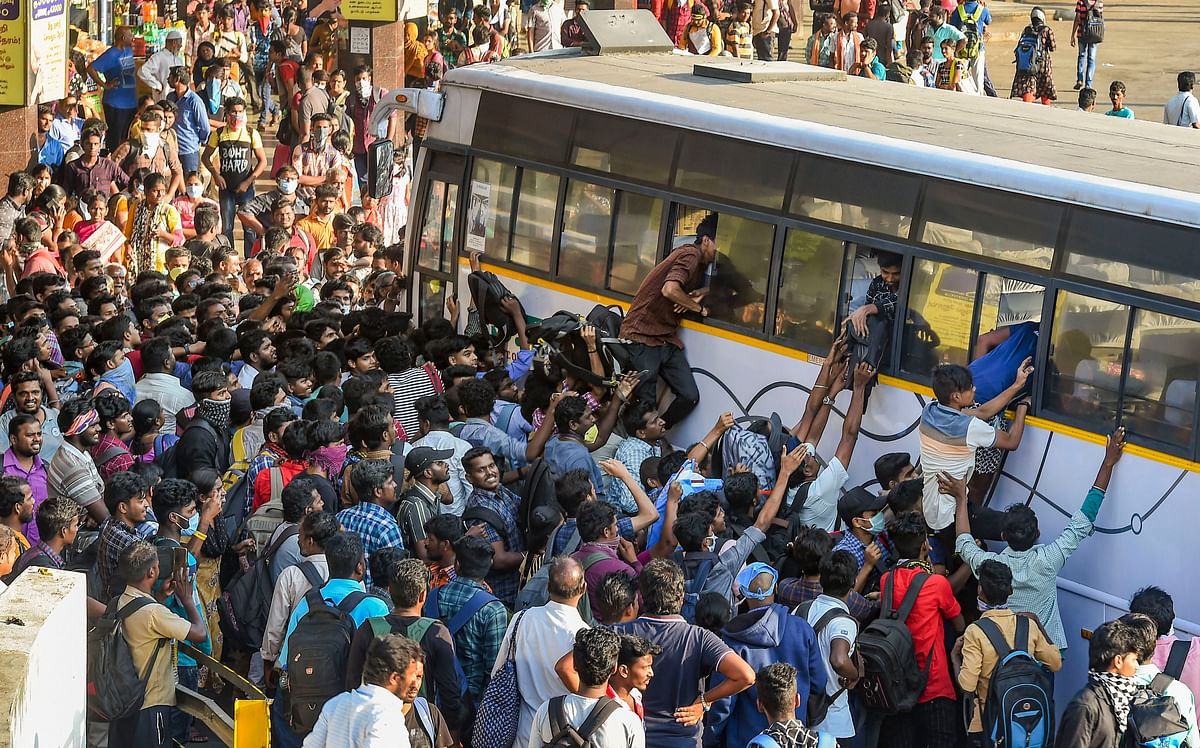 Passengers rush to board State Express Transport Corporation of Tamilnadu (SETC) bus after lockdown announcement in view of coronavirus pandemic, at Koyambedu bus terminal, in Chennai, Monday, March 23, 2020/ File
