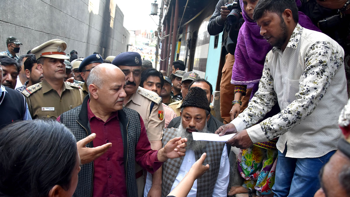Delhi Deputy CM Manish Sisodia interacts with local residents during his visits to riots affected area of north-east Delhi at Shiv Vihar in New Delhi on Tuesday.