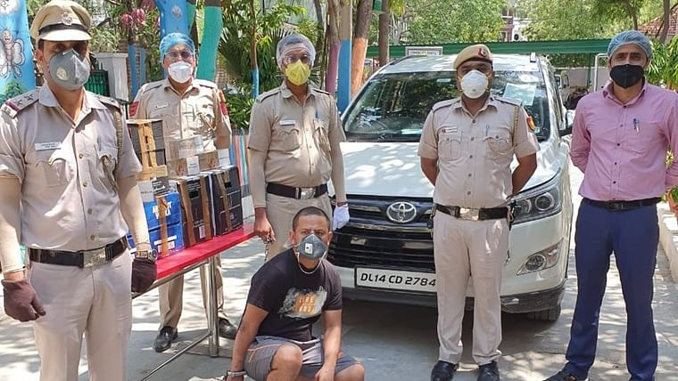 Delhi Police arrests man with illegal foreign imported liquor, 60 cigarette boxes amid lockdown