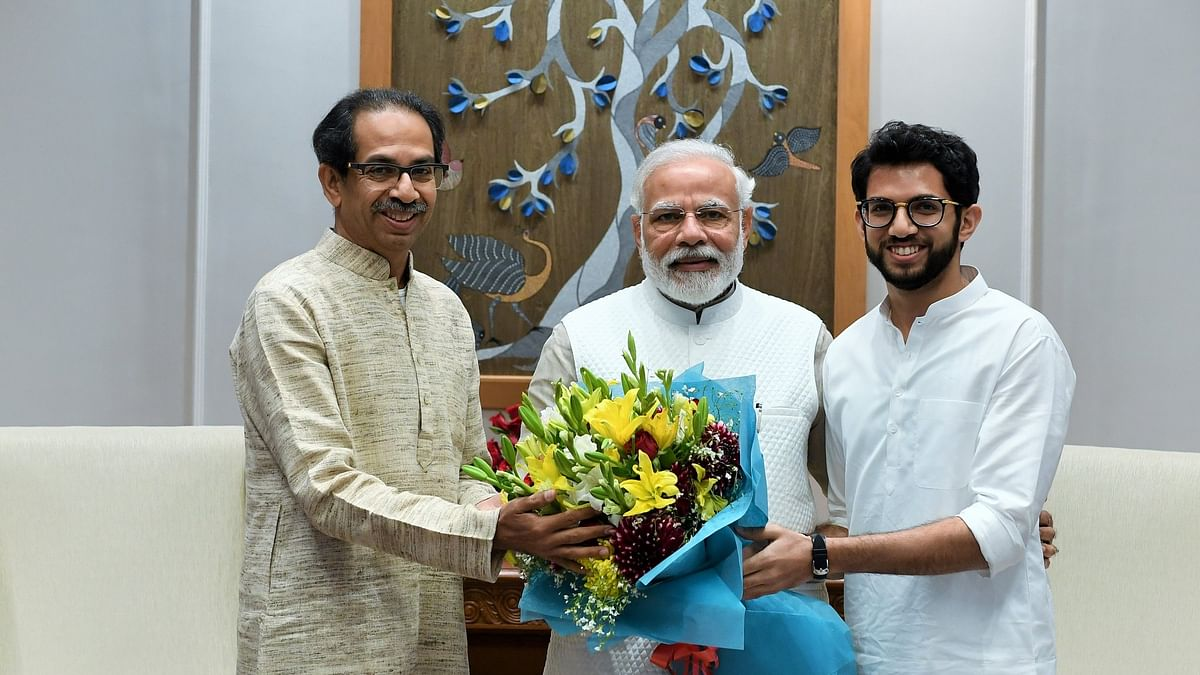 Aaditya Thackeray (R) with PM Modi and Uddhav Thackeray
