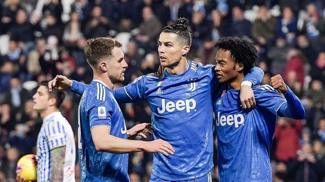 Aaron Ramsey (L), Cristiano Ronaldo and Juan Cuadrado