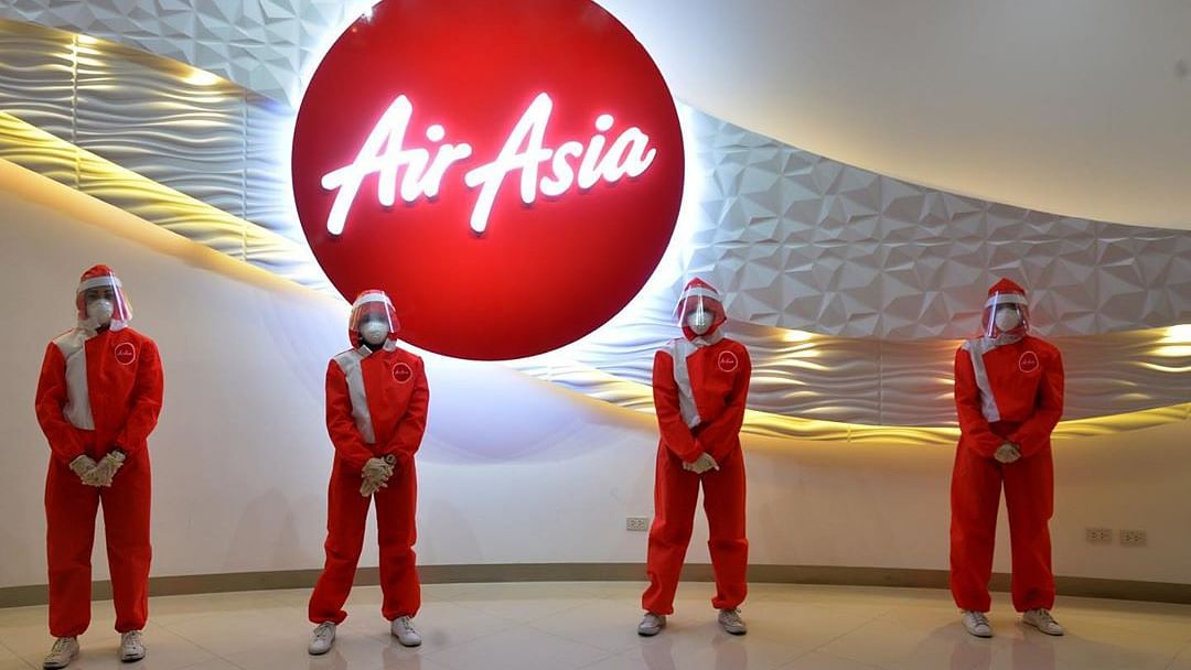 AirAsia India 'draining cash'; reviewing investment in joint venture: Malaysia's AirAsia Group