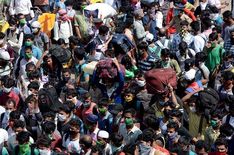 Human Cargo: Hundreds of migrants gather outside Bandra station in Mumbai
