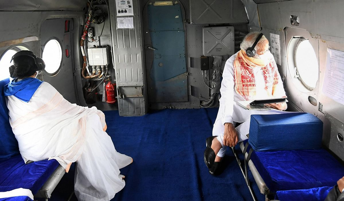 Prime Minister Narendra Modi and Chief Minister Mamata Banerjee during an aerial survey of areas affected by Cyclone Amphan in West Bengal