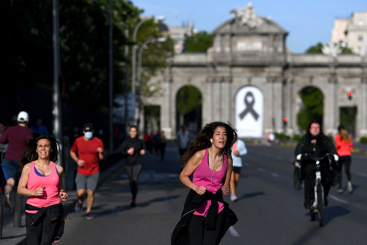 People exercise in Madrid on Saturday morning after government relaxed lockdown.