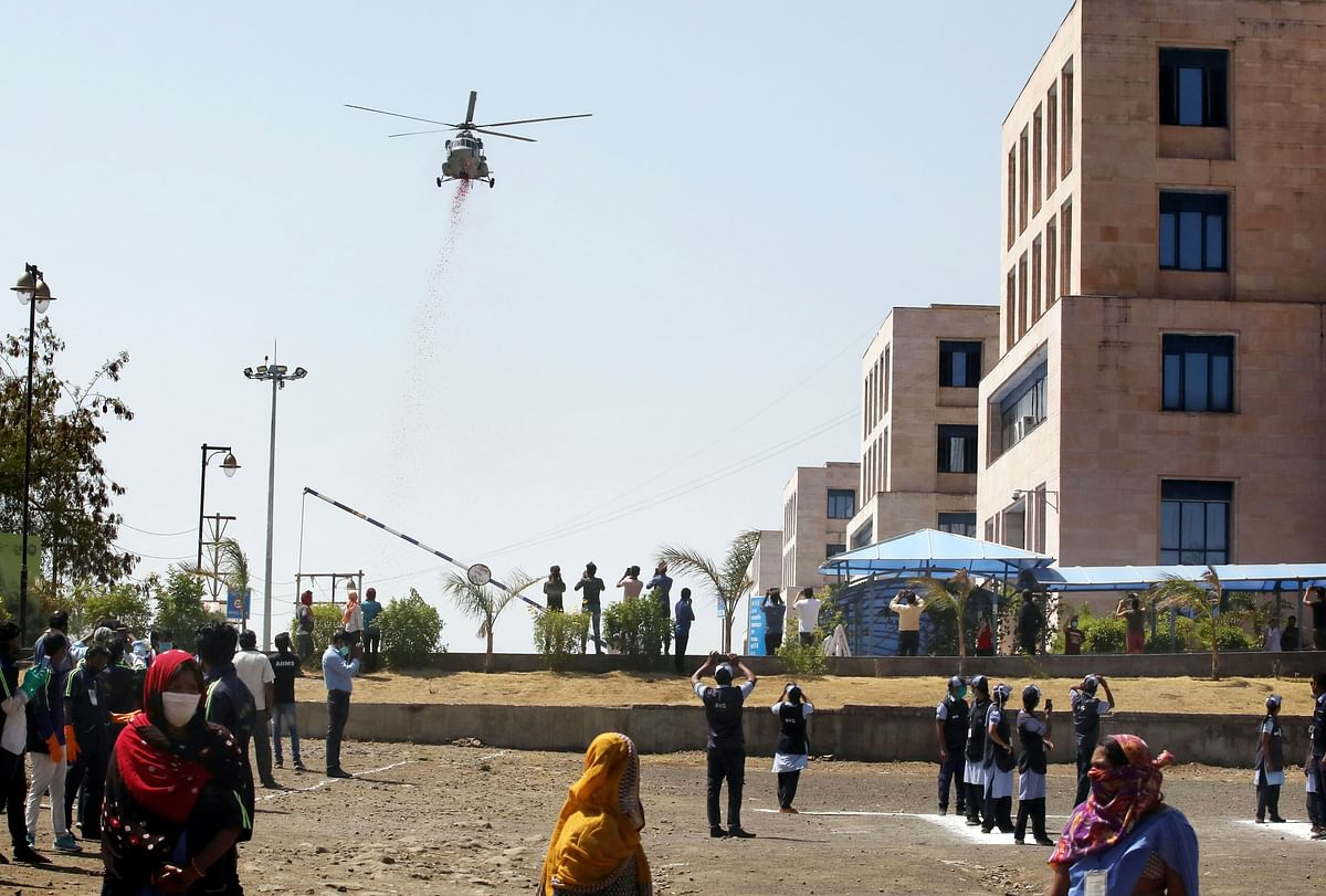 Indian Air Force (IAF) helicopter conducts flypast and shower flower petals on All India Institute of Medical Sciences (AIIMS) to show gratitude towards doctors, paramedics and other corona warriors engaged in the country's fight against the coronavirus pandemic, in Bhoopal on Sunday.