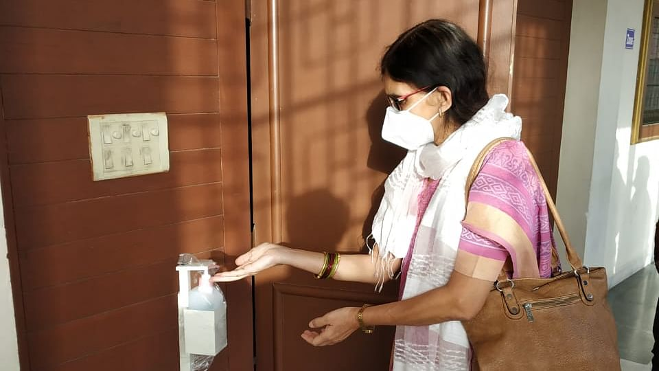 Vice chancellor Prof Renu Jain sanitizing her hands before entering the auditorium for meeting on Friday.