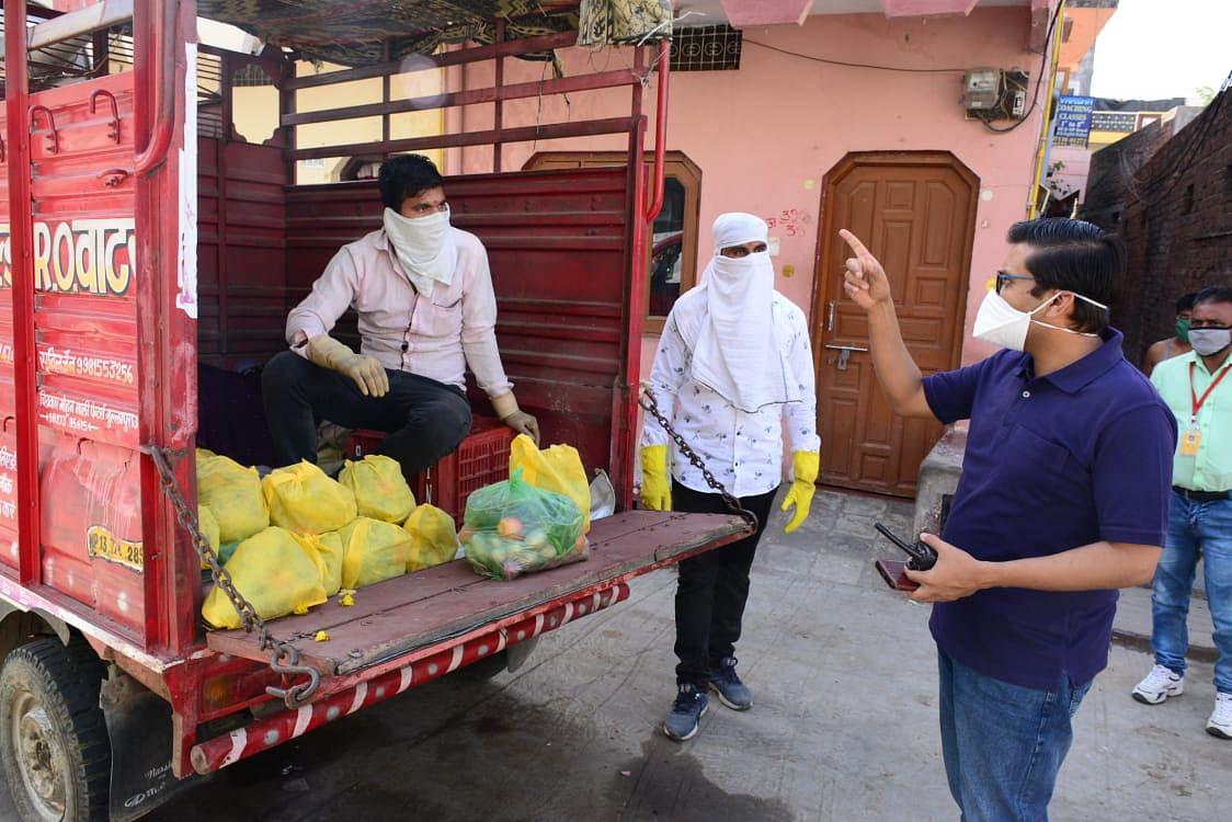 Municipal Commissioner Rishi Garg reprimands a veggie vendor.