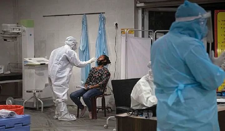 A doctor conducts a swab test for coronavirus.