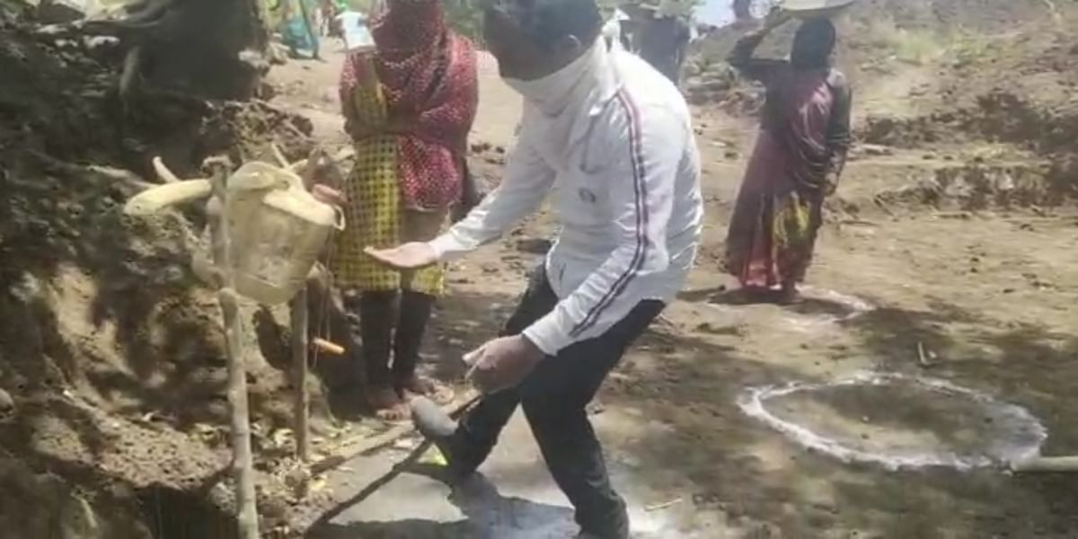 Indore: Khandwa villagers assemble a foot-operated washbasin to sanitise people coming in their village amid coronavirus pandemic