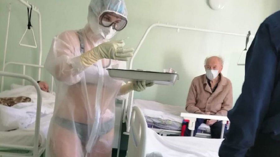 "Russian nurse wears lingerie under PPE suit, says ""it gets too hot for clothes"""
