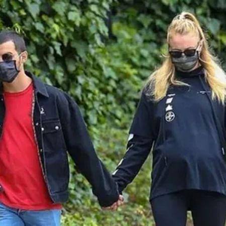 Sophie Turner flaunts baby bump on a stroll with hubby Joe Jonas