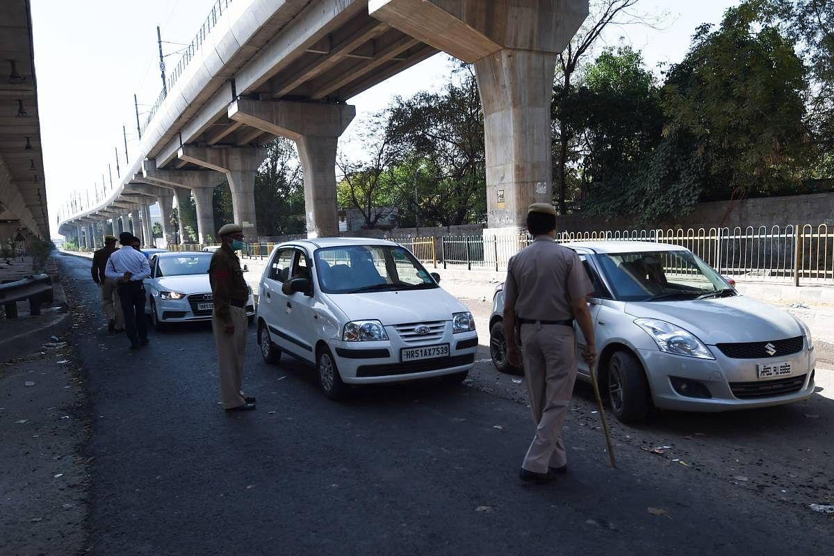 2 brothers booked for driving a car with 'official stickers'