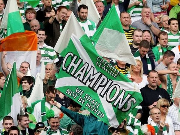 Nine in a row for Celtic, crowned champions of Scottish football without having kicked one in two months