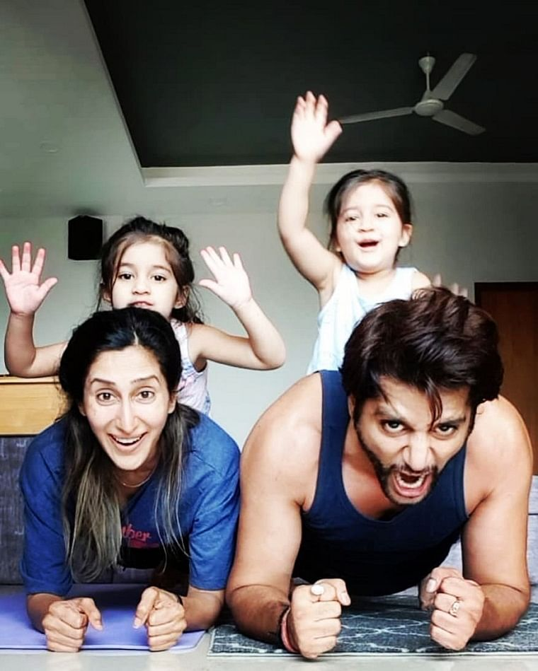 Karanvir with wife Teejay and twin daughters