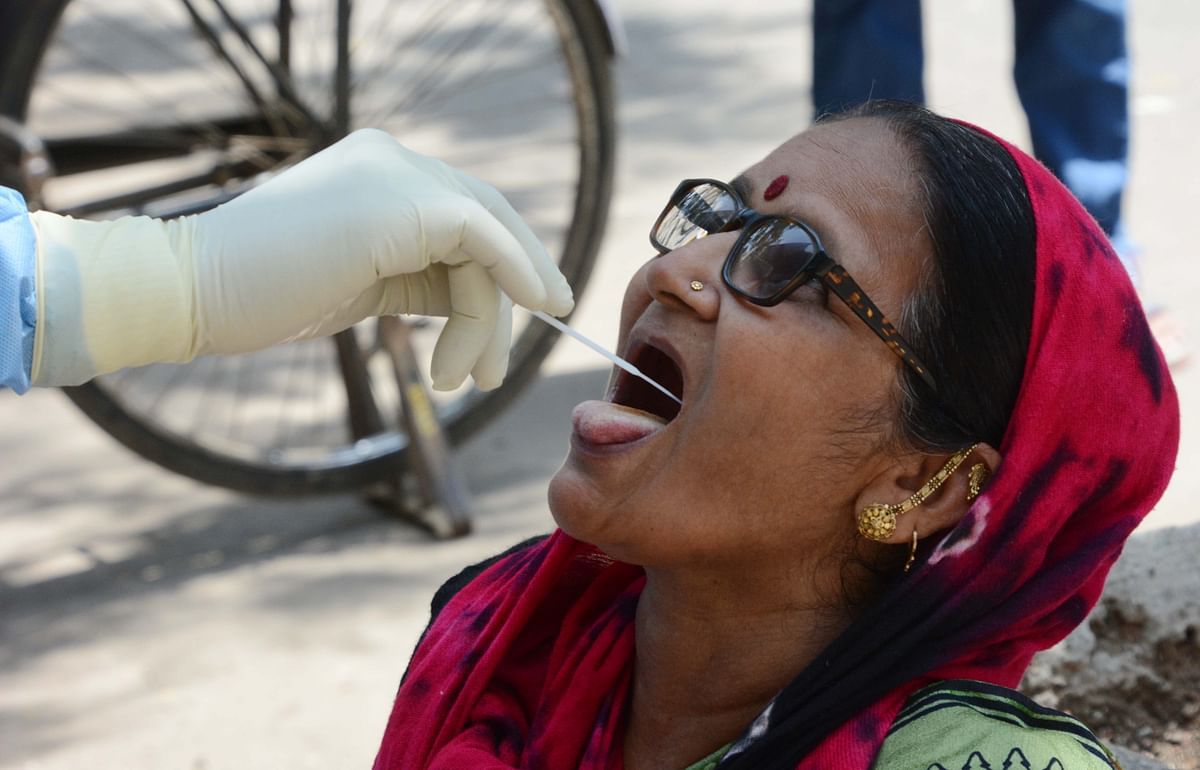 A woman giving swab sample for the COVID-19 test (Representative Pic)