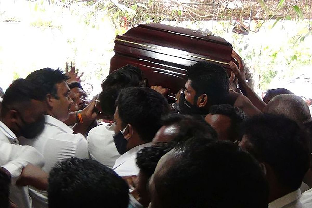 Sri Lanka fears second wave of coronavirus after thousands gather to pay tribute to Tamil leader