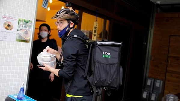 From medal to pedal, Japan's Olympic fencer Ryo Miyake turns food delivery boy
